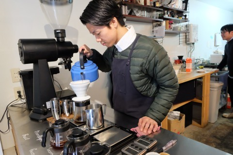 Barista making a pour-over at Switch Coffee Tokyo Meguro Japan