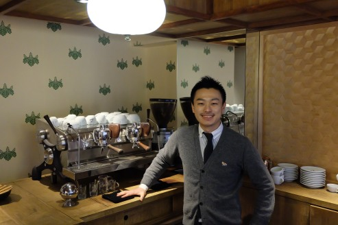 Smiling Barista by Slayer Espresso Machine at Cafe Kitsune Aoyama Tokyo Japan