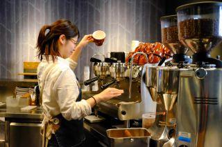 Barista making espresso at The Roaster by Nozy Coffee Jingumae Tokyo Japan