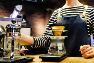 Barista preparing a pour-over at The Roaster by Nozy Coffee Jingumae Tokyo Japan