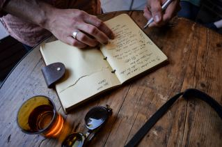 Scribbling in a notebook at The Roaster by Nozy Coffee Jingumae Tokyo Japan