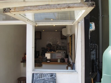 Outside of cafe looking in Woodberry Coffee Roasters in Yoga Tokyo Japan