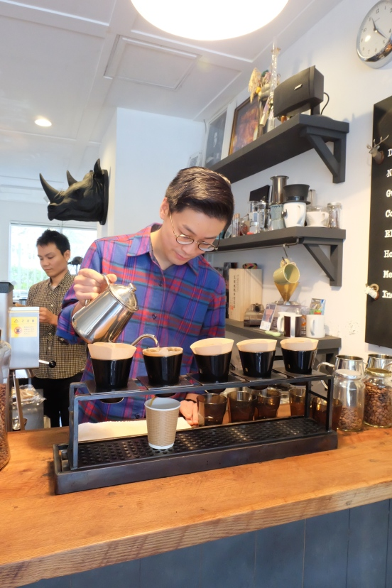 Barista making pour-over at Arise Coffee Entangle Kiyosumi Shirakawa Tokyo Japan