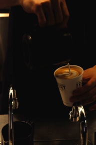 Barista Pouring Latte Art at The Roastery by Nozy Coffee in Shibuya Tokyo Japan
