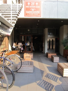 Sine shining on benches outside The Roastery by Nozy Coffee in Shibuya Tokyo Japan