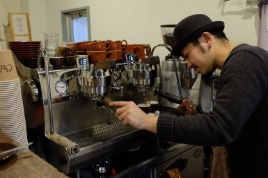 Barista making espresso at Life Size Cribe in Kokubunji Tokyo Japan