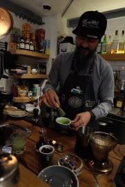 Barista Making a Matcha Latte at Deus ex Machina Harajuku Cafe Tokyo Japan