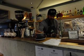 Deus ex Machina barista serving up a latte in Harajuku Tokyo Japan