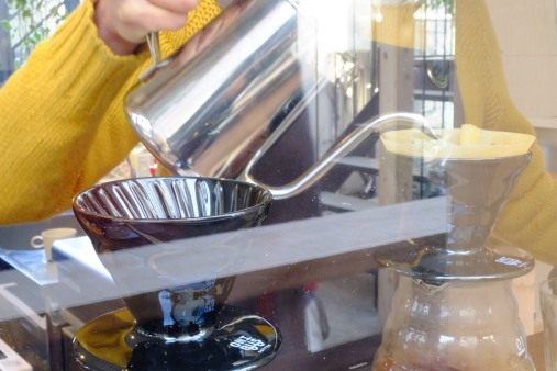 Hario V60 pour over by barista at Onibus Coffee Nakameguro Tokyo Japan Cafe