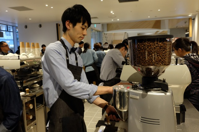 Barista at La Marzocco espresso machine at Blue Bottle Coffee Shinjuku Tokyo Japan