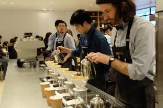 Baristas making pour over coffee at Blue Bottle Coffee Shinjuku Tokyo Japan