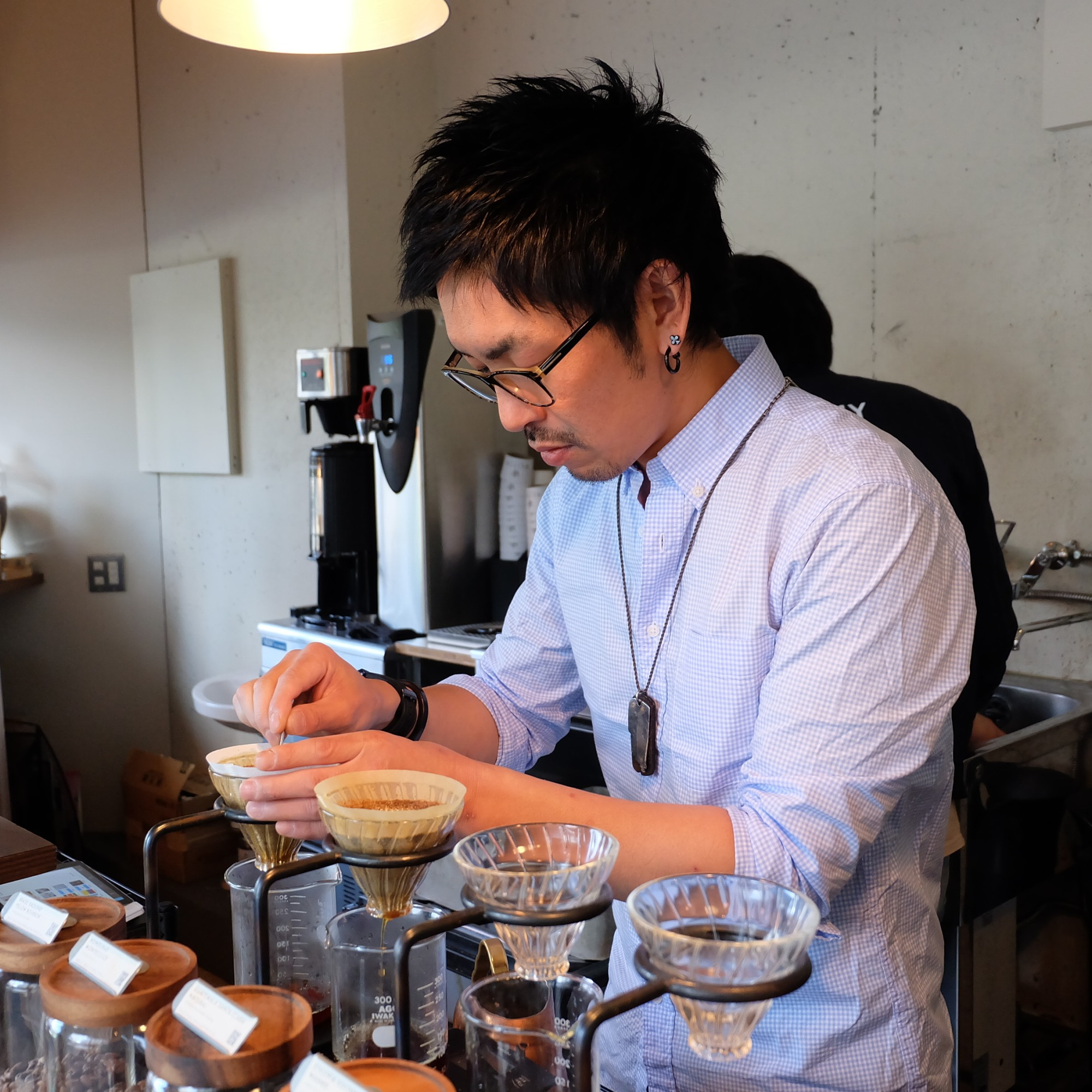 Barista at Glitch Coffee and Roasters in Jimbocho Tokyo Japan