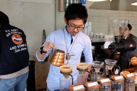 Barista making a pour over at Glitch Coffee and Roasters in Jimbocho Tokyo Japan