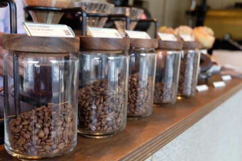 Row of Jars filled with coffee beans at Glitch Coffee and Roasters in Jimbocho Tokyo Japan