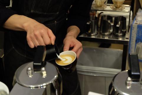 Barista pouring latte art at Amameria Espresso Shinagawa Tokyo Japan Cafe