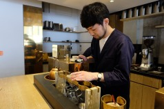 Barista with copper kettle at Cobi Coffee in Aoyama Tokyo Japan