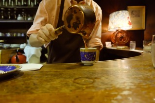 Barista pouring coffee at Cafe de Lambre Kissaten Cafe in Ginza Tokyo Japan