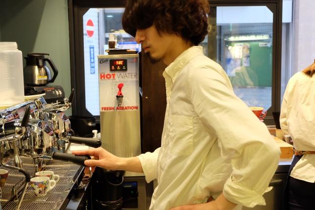 Barista at Espresso Machine at Sarutahiko Coffee in Beams Japan Shinjuku Tokyo