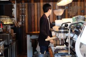 Close up of La Marzocco Strada with Barista at Unlimited Coffee Bar in Narihira Tokyo Japan