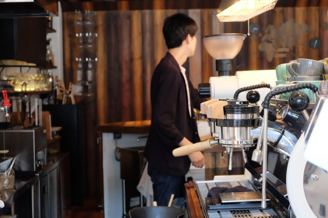 Close up of La Marzocco Strada with Barista at Unlimited Coffee Bar in Narihira Tokyo Japan