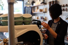 Female Barista at Espresso Machine at Unlimited Coffee Bar in Narihira Tokyo Japan