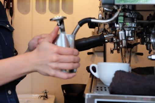 Barista making latte at Counterpart Coffee Gallery Nishi Shinjuku Tokyo Japan