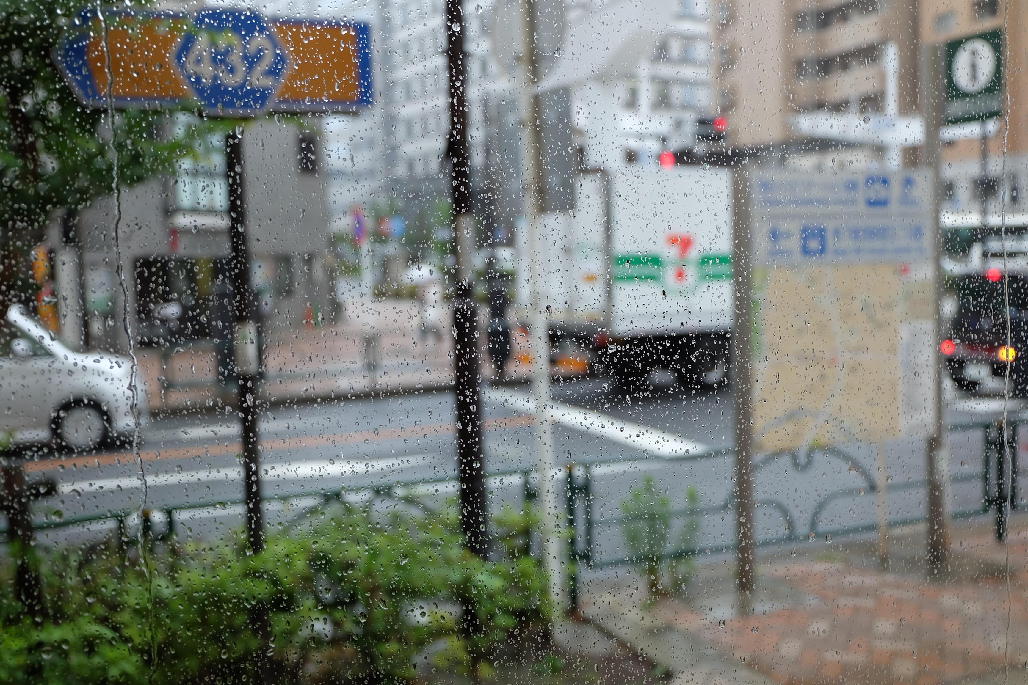Rain on a window at Counterpart Coffee Gallery Nishi Shinjuku Tokyo Japan