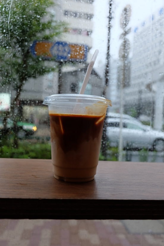 Iced Coffee by Rainy Window at Counterpart Coffee Gallery Nishi Shinjuku Tokyo Japan