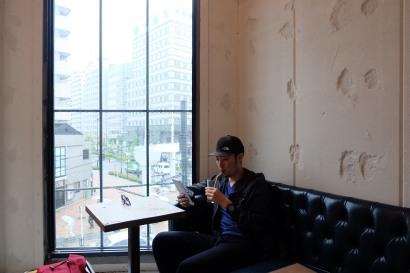 Customer on a Sofa at Counterpart Coffee Gallery Nishi Shinjuku Tokyo Japan