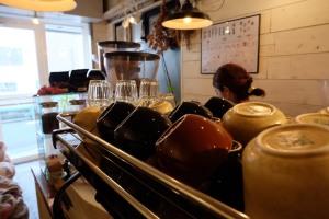 Up close coffee cups on espresso machine at Onibus Okusawa Tokyo Japan