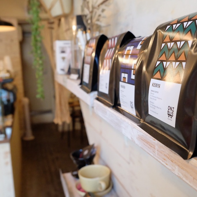 Coffee bags lined on a shelf at Onibus Coffee Okusawa Tokyo Japan
