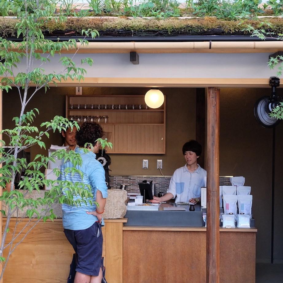 Customer waits with Baristas at Weekenders Coffee Kyoto Tominokoji