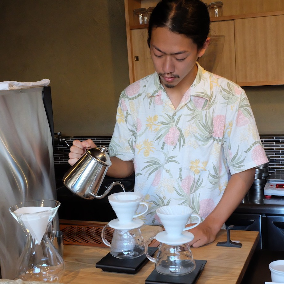 Barista at Weekenders Coffee Tominokoji Kyoto preparing coffee via pour-over