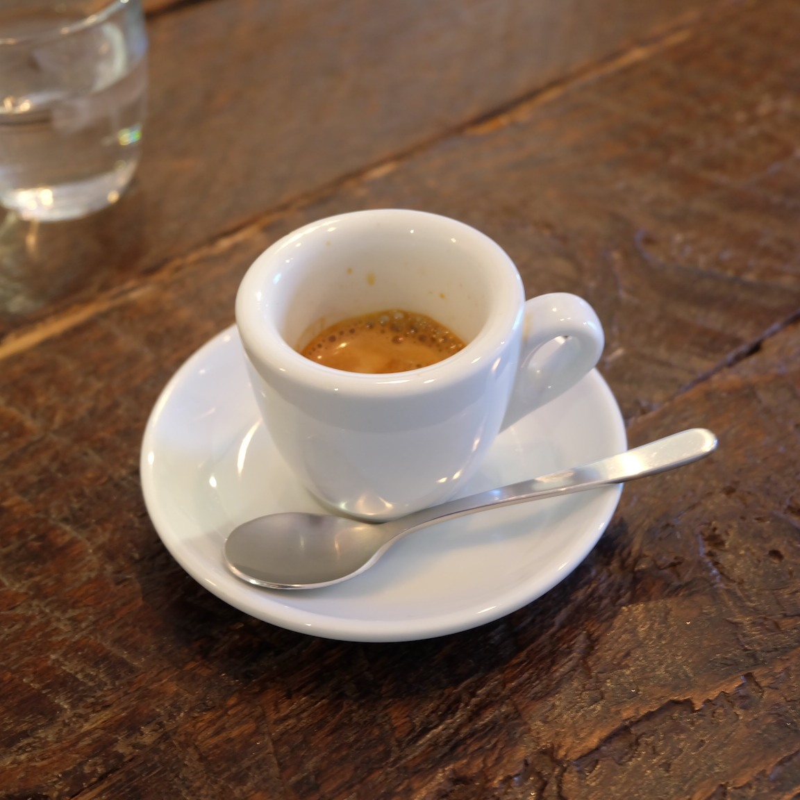 Espresso in white demitasse cup at Iron Coffee at Gotokuji Tokyo Japan